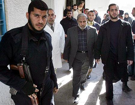 Mahmoud Zahar leaving Shifa Hospital in Gaza City - AFP photo