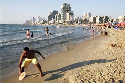 An idiots guide to the tel aviv beach the israeli beach more proof that israel is a war zone photo ap publicscrutiny Image collections