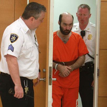 אהרון בבית המשפט (צילום: AP)