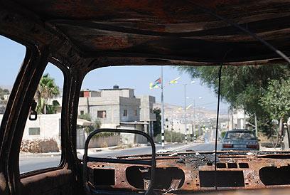 """ברחובות הכפר קוסרה. """"חמ""""ל פלסטין"""" (צילום:  סאמי חמיד, זום אאוט הפקות)"""
