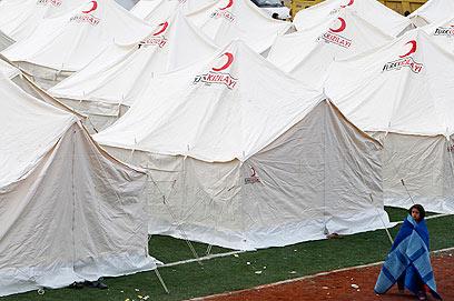 עיר אוהלים. תלונות על מחסור וקור (צילום: רויטרס)