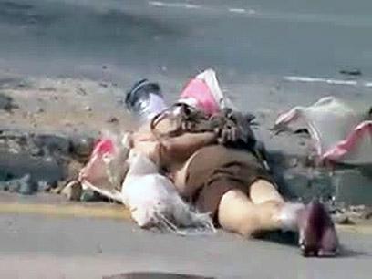 נהרגו בעת שידיהם נכפתו מאחורי גבם. חומס (צילום: AFP PHOTO / YOUTUBE)