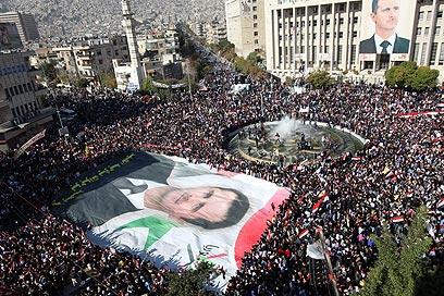 הפגנת תמיכה באסד השבוע בסוריה (צילום: EPA)