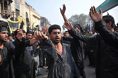 ואלה הם גברי הודו השיעים (צילום: AFP)