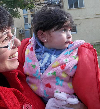 Meital Trebalsi with her one-year-old daughter. 'We want to raise our children in Sderot' (Photo