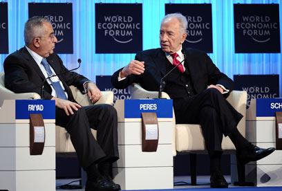 פרס ופיאד בדאבוס. צריכים או לא צריכים עזרה?  (צילום: AFP)