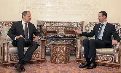 """לברוב ואסד בדמשק. """"פגישה טובה"""" (צילום: AFP)"""