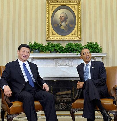 אובמה לצד עמיתו הסיני שי ג'יפינג (צילום: AP)