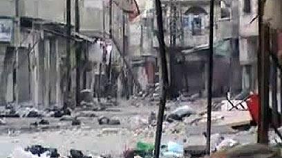ההרס ברחובות חומס (צילום: AFP PHOTO / YOUTUBE)