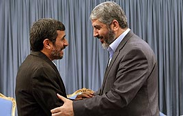 Iranian President Mahmoud Ahmadinejad (L), Hamas Politburo Chief Khaled Mashaal (Photo: AFP)