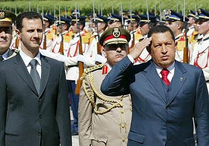 עם נשיא סוריה, בשאר אסד (צילום: איי אף פי)
