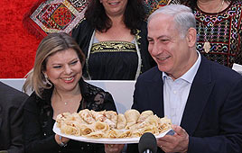 PM Netanyahu and wife Sara at Mimouna celebration (Photo: Ido Erez)