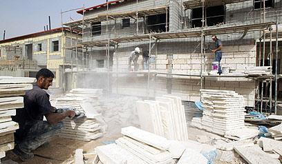"""ארכיון. """"סגרנו עם האדריכל והקבלן הראשונים שפגשנו"""" (צילום: AFP)"""