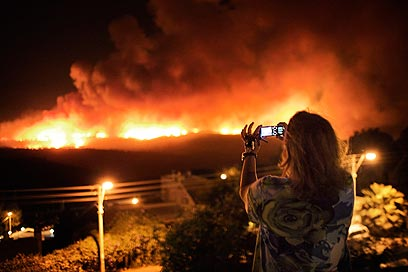 """""""אסון שכזה יכול היה להתרחש גם אילו היה מערך הכיבוי נמצא בשיא כושרו""""  (צילום: AFP)"""