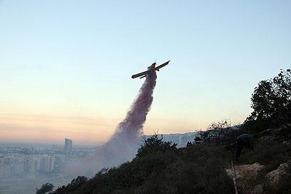 """""""אובמה שאל דבר ראשון על מטוסי הכיבוי"""" (צילום: אריק ניסימוב, כבאות והצלה)"""