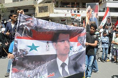 תמונות של אסד בצפון הגולן (צילום: אביהו שפירא)
