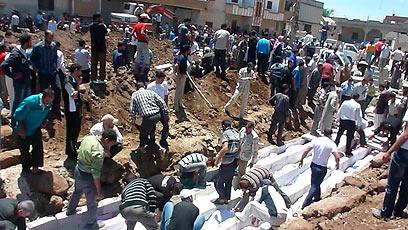 Aftermath of Houla massacre (Photo: Reuters)