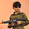 Palestinian boy dressed as IDF soldier