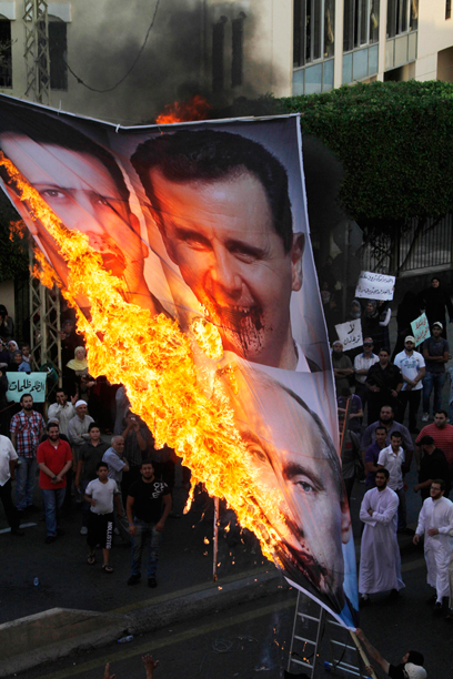 הפגנה בלבנון נגד אסד (צילום: AP)