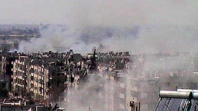 שכונת חאלידיה בחומס חרבה  (צילום: AFP/HO/ SHAAM NEWS NETWORK)