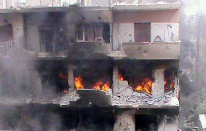 אל-חאלדיה, מבט מקרוב. תחת אש (צילום: AFP/HO/ SHAAM NEWS NETWORK)
