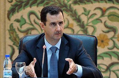 אסד בהשבעת הממשלה (צילום: AFP,HO, SANA)