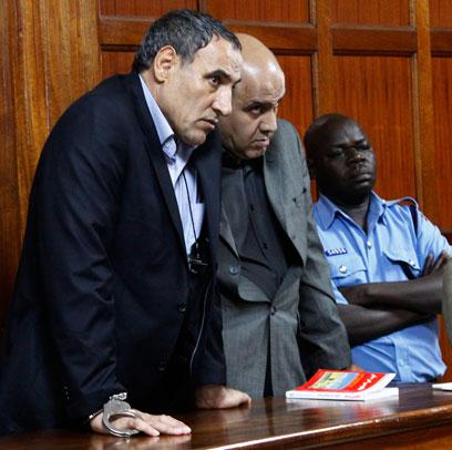 החשודים בבית המשפט (צילום: AP)
