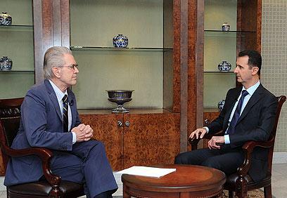 """אסד בראיון אמש. """"ארה""""ב אחראית להרג אזרחים חפים מפשע"""" (צילום: AFP, SWR)"""