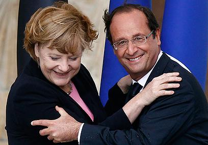נשיא צרפת הולנד וקנצלרית גרמניה מרקל (צילום: רויטרס)