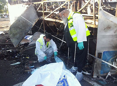 ZAKA workers at the scene of the Israeli bus bombing