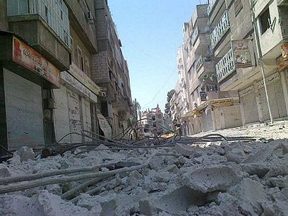 רחובות דמשק המופגזים (צילום: רויטרס)