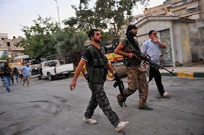 מורדים בעיר חלב, השבוע (צילום: AFP)