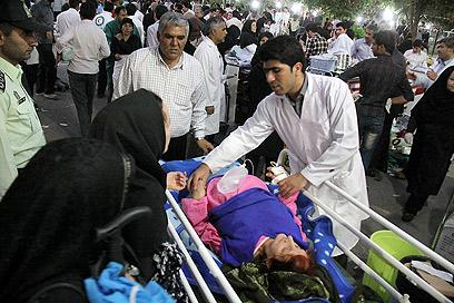 מאות פצועים פונו לבתי החולים (צילום: AFP)