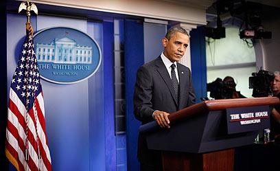"""אובמה בבית הלבן. """"ליכד את הקהילה הבינלאומית"""" (צילום: AP)"""
