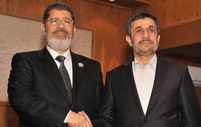 פגישת מורסי ואחמדינג'אד בטהרן לאחר הפסגה במכה (צילום: רויטרס)