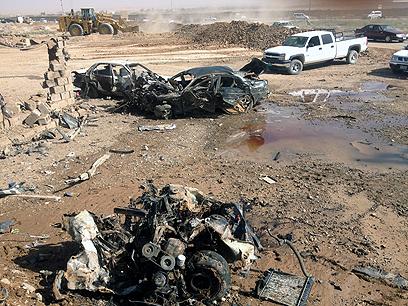 זירת פיגוע בעיראק. בראש הרשימה (צילום: EPA)