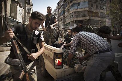 המורדים בסוריה. נלחמים גם באיראן וברוסיה? (צילום: AFP)