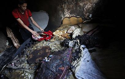 שריפה במהלך הפסקת חשמל (צילום: AFP)