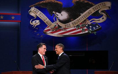"""""""רומני לא היה על הבימה"""". אובמה ויריבו הרפובליקני, הלילה (צילום: AFP)"""