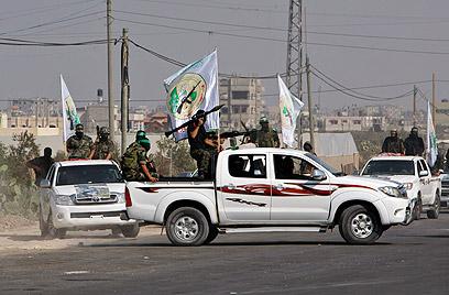 אנשי הזרוע הצבאית של חמאס (צילום: AP)