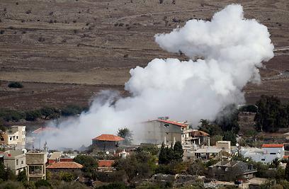 """הכפר בריקה לאחר ירי התגובה של צה""""ל (צילום: AP)"""