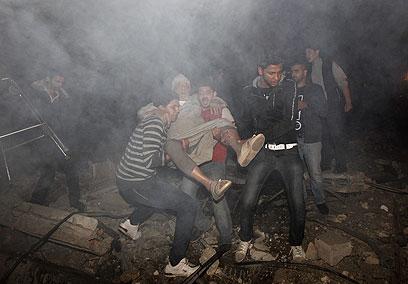 """צה""""ל תוקף בעזה (צילום: AFP)"""