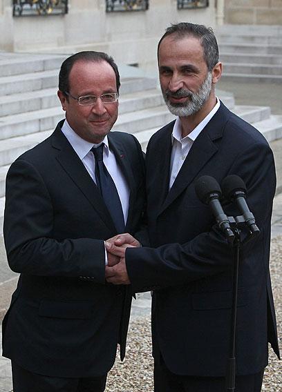 נשיא צרפת מקבל את פני ראש האופוזיציה בפריז (צילום: AP)
