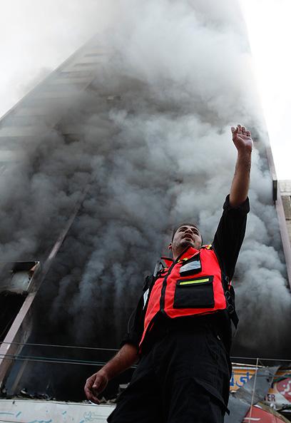 """תקיפות, שיגורים ותדרוכים. יום שישי למבצע """"עמוד ענן"""" (צילום: EPA)"""