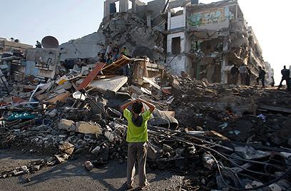 """תוצאות תקיפה ישראלית במהלך """"עמוד ענן"""" (צילום: AP)"""