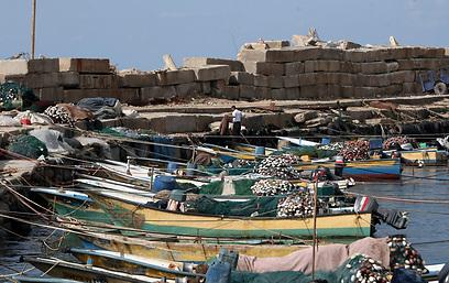 """דייגי עזה. """"מחייכים בעיתונות הבינלאומית"""" (צילום: AFP)"""