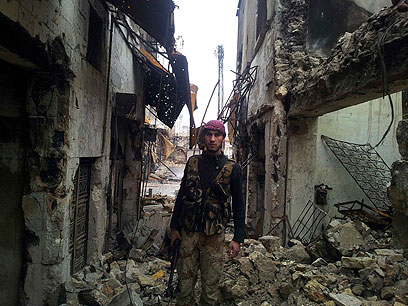 מורד בעיר חלב (צילום: רויטרס)