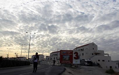 """""""בנייה ב-E1 - סטירת לחי גרועה יותר ממה שקרה בביקור ביידן"""" (צילום: רויטרס)"""
