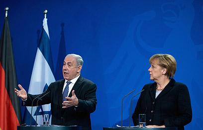 לא רואים עין בעין. מרקל ונתניהו, היום (צילום: AFP)