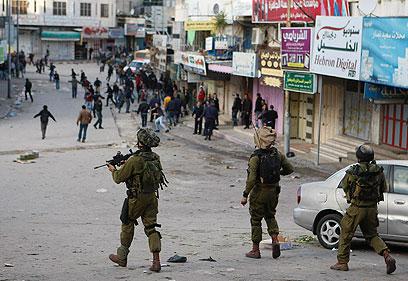 העימותים בחברון בשבוע שעבר (צילום: רויטרס)